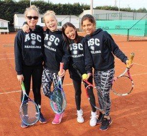 elementary girls tennis hug